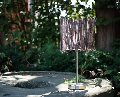 Bring nature indoors by using materials from trees to spruce up old household items, like this lamp shade.