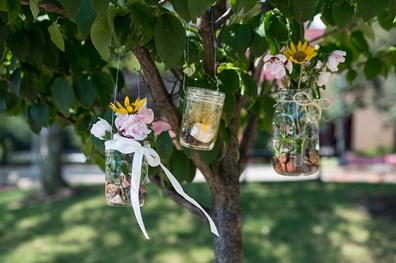 You can decorate trees in the summertime, too! Learn how to make these mason jar vases below.