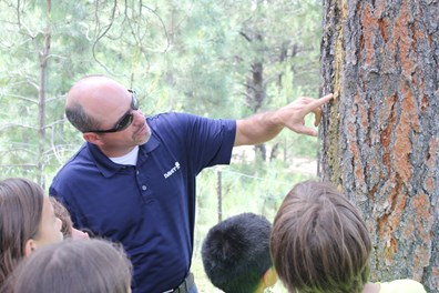 Andy Ferguson, operations manager for the south central region of Davey's residential/commercial services, teaches JCC Ranch Camp attendees how to identify trees.