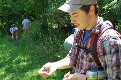 Kyle McLoughlin, climber with Davey's Hamilton office, describes edible berries on a recent hike.