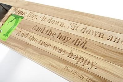 """Maier Tree & Lawn, a Davey company, turned leftover wood from a tree removal into a bench for an annual charity gala. """"The Giving Tree"""" by Shel Silverstein reminds us to be grateful for one another by sharing the story of a young boy who grows old with his tree."""