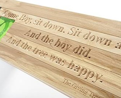 "Maier Tree & Lawn, a Davey company, turned leftover wood from a tree removal into a bench for an annual charity gala. ""The Giving Tree"" by Shel Silverstein reminds us to be grateful for one another by sharing the story of a young boy who grows old with his tree."