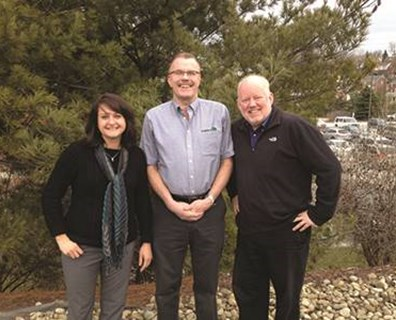 "Davey's Ron Hegner (center) greets Pittsburgh's KDKA NewsRadio 1020 ""Talking Trees"" hosts Jessica Walliser and Doug Oster."