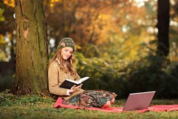 woman reading in fall - WEB