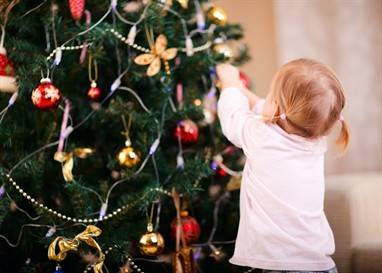 girl decorating xmas tree - Copy