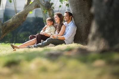 family sitting beneath tree