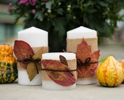 Dress up your seasonal fall tablecloth with these simple, festive candle accessories!