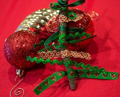 This ribbon Christmas tree is easy for kids to create for a holiday ornament, decoration or gift.