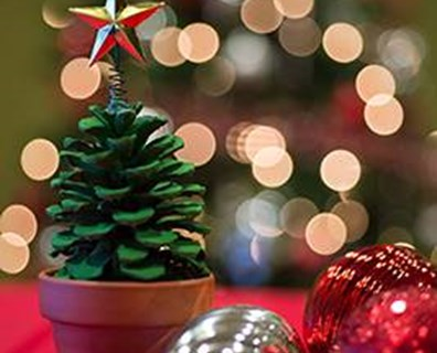 Use this DIY pine cone Christmas tree as a table decoration for the holidays.