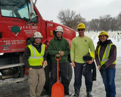 Davey's Robert Raymond and Pat Worden and S&S Tree's Jon Schmidt and Emily Mumford (pictured left to right) gather for a photo while volunteering for the Minnesota ISA Chapter Day of Service in Minneapolis, Minnesota, late last year.