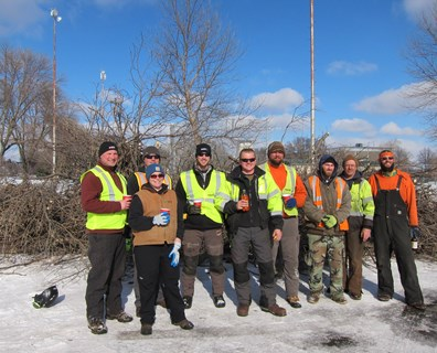 Don Mueller (far left), Jen Morgan (second from left, front), Eric Foley (third from left) and Jarred Robinson (fifth from left) join other local arborists and volunteers during the Minnesota ISA Chapter Day of Service in Rochester, Minnesota.