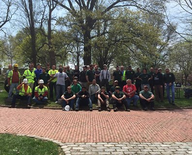 All ISA Penn-Del Chapter Day of Service volunteers gather for a group photo at the Historic Fair Hill Burial Ground.